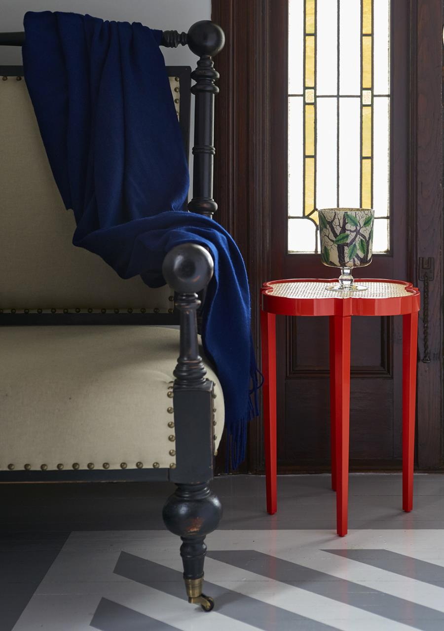 Red-quatrefoil-table-in-an-entryway