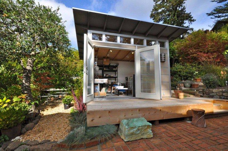 cabane-jardin-moderne-moderne-bricolage-terrasse-bois-jardin-pavés ...